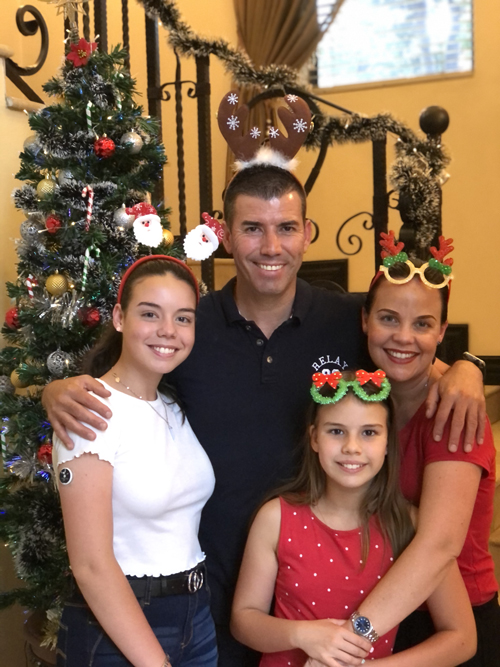 Isabella with her parents, Ashleigh and Carlos and sister, Sienna.